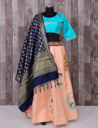 Aqua and peach color silk lehenga choli