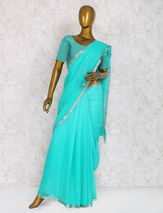 Aqua color festive saree in chiffon