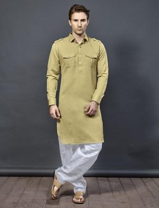 Beige color festive cotton pathani suit