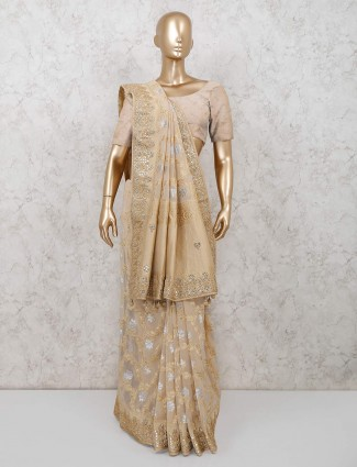 Beige colored georgette saree