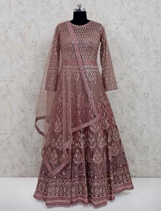 Beige designer net floor length gown