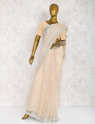 Beige hue net fabric wonderful saree