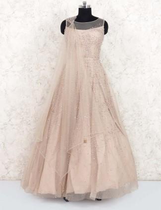 Beige hue net floor length gown for wedding