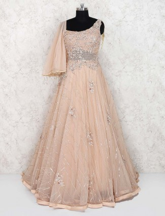 Beige hue net party wear gown