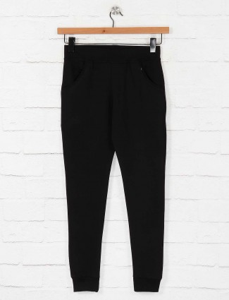 Black colored cotton solid jeggings
