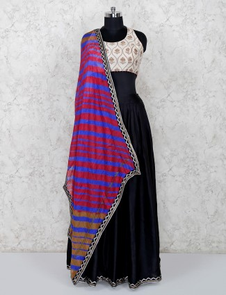 Black lehenga and beige blouse with leheriya dupatta