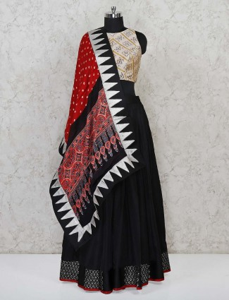 Black silk lehenga with bandhej blouse and bandhej dupatta