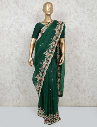 Bottle green embroidery saree design in organza tissue