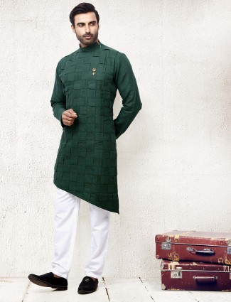 Bottle green solid cotton fabric kurta suit