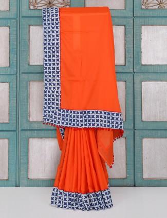 Bright orange color plain saree