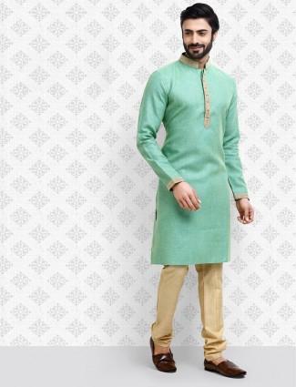Cotton fabric green hue festive wear kurta suit