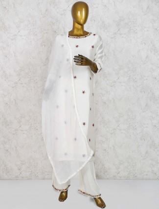 Cotton silk white hued festive punjabi palazzo suit