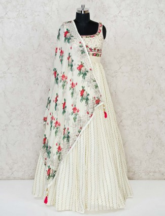 Cream Anarkali dress with colorful embroidery