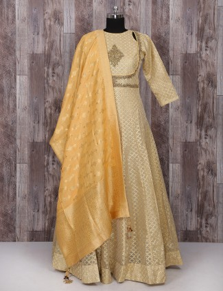 Cream and gold net anarkali suit