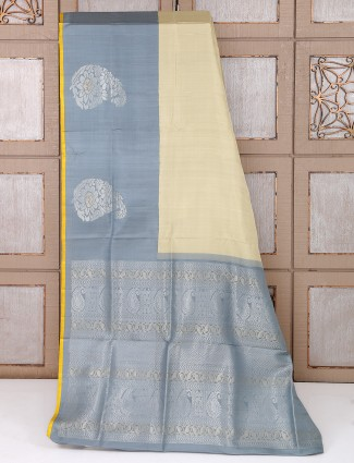 Cream and grey color saree