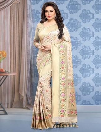 Cream color banarasi silk festive wear saree