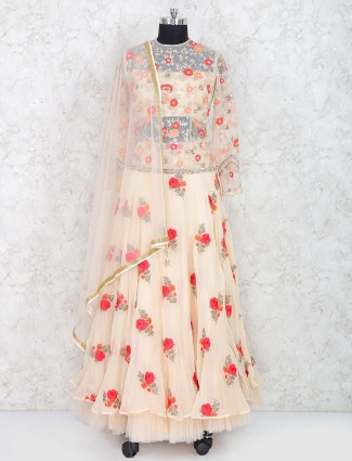 Cream color lahenga choli in net fabric