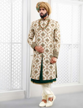 Cream colored designer groom wear sherwani