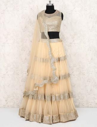 Cream hue wedding wear net fabric lehenga choli