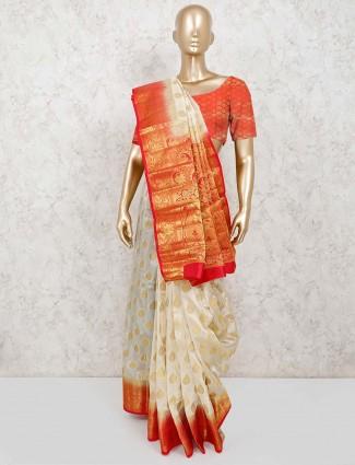 Cream jacquard design saree with unstitched blouse piece