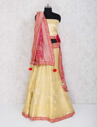 Cream silk fabric semi stitched lehenga choli