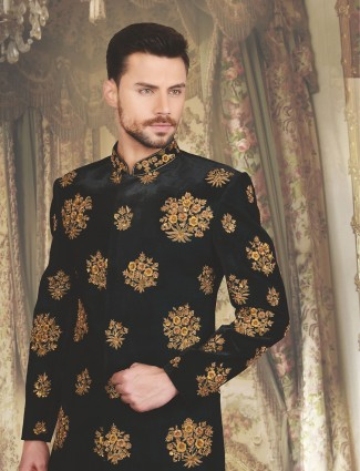 Dark green wedding wear velevt sherwani