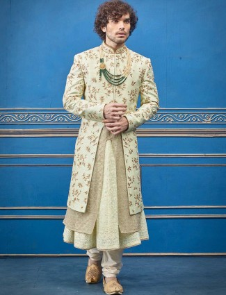 Designer pista green raw silk layer style sherwani