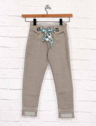 EBONY presented solid beige color jeans