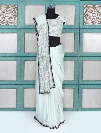 Exclusive aqua color satin fabric saree with ready made blouse
