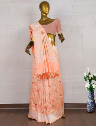 Exclusive pretty peach kanjivaram wedding saree