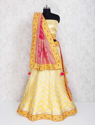 Exclusive yellow semi stitched lehenga choli in silk fabric