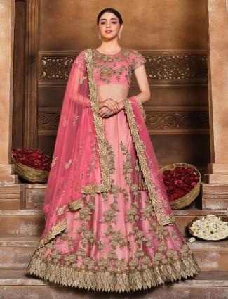 Fabulous wedding wear semi stitched lehenga choli in tomato red colored