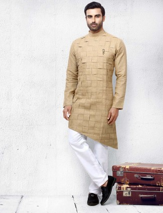Festive function beige colored solid kurta suit