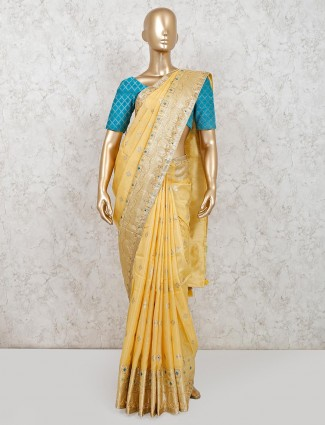 Festive wear yellow muga silk saree