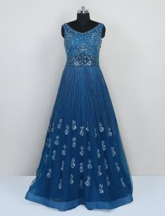 Floor length blue net gown for wedding function