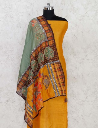 Golden colored dress material in cotton