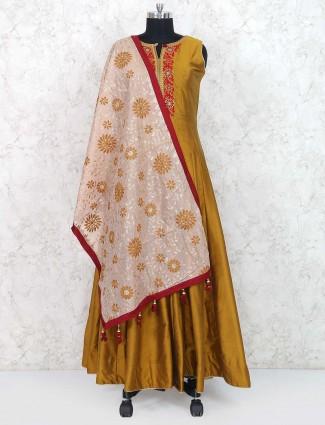 Golden hue raw silk anarkali suit