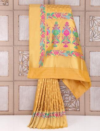 Golden wedding wear saree in silk fabric