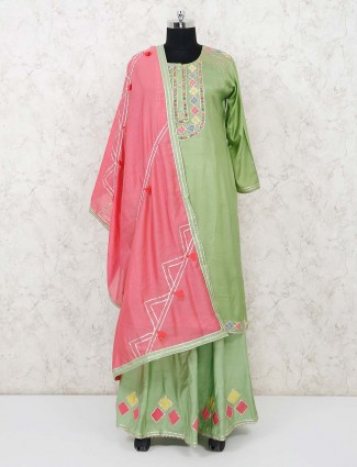 Green cotton silk palazzo salwar kameez in gota work