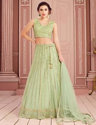 Green lehenga choli in net with zari and sequins work
