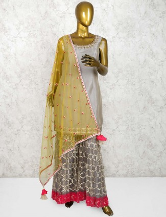 Grey colored hue punjabi sharara suit in cotton silk