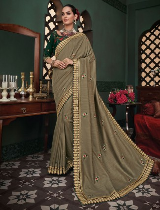 Latest designer raw silk festive wear sari in beige