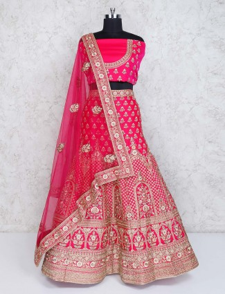 Lehenga choli in magenta semi stitched silk fabric