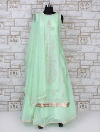 Light green colored silk anarkali suit
