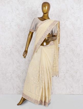 Lovely beige color festive wear georgette saree