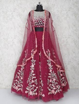 Maroon hue net lehenga choli with shrug