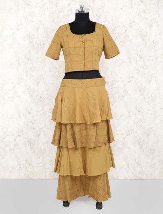 Mustard yellow party wear layer style checks pattern lehenga choli
