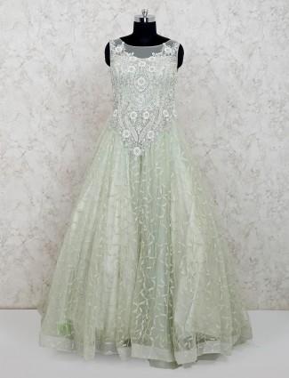 Net pista green floor length gown for wedding