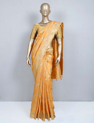 Orange designer latest muga silk saree for wedding functions