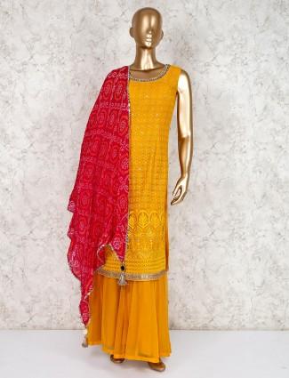 Orange geogette punjabi sharara suit for party wear